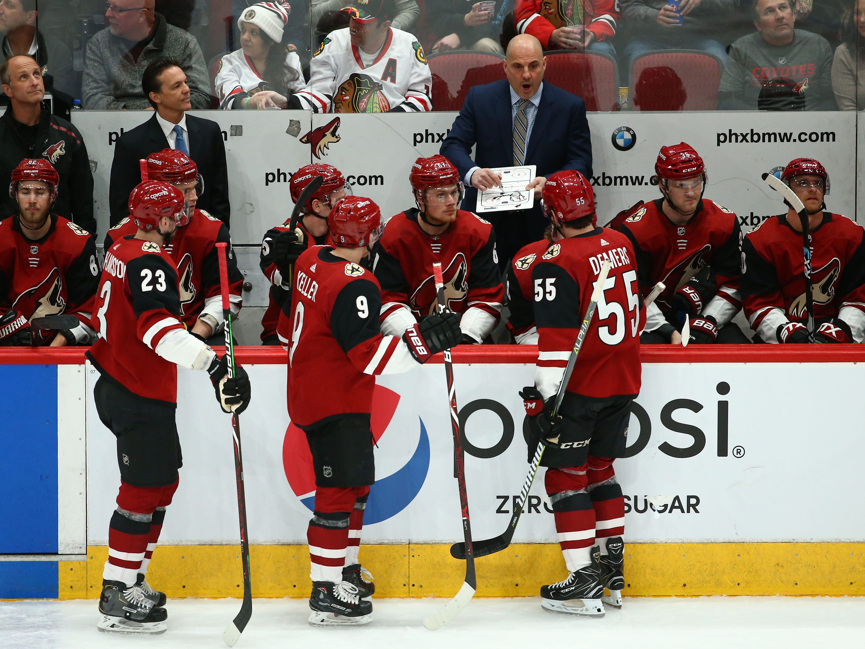 Arizona Coyotes head coach Rick Tocchet talks to his players during a time out against the Chicago Blackhawks in the first period on Mar. 26, 2019, at Gila River Arena in Glendale, Ariz.