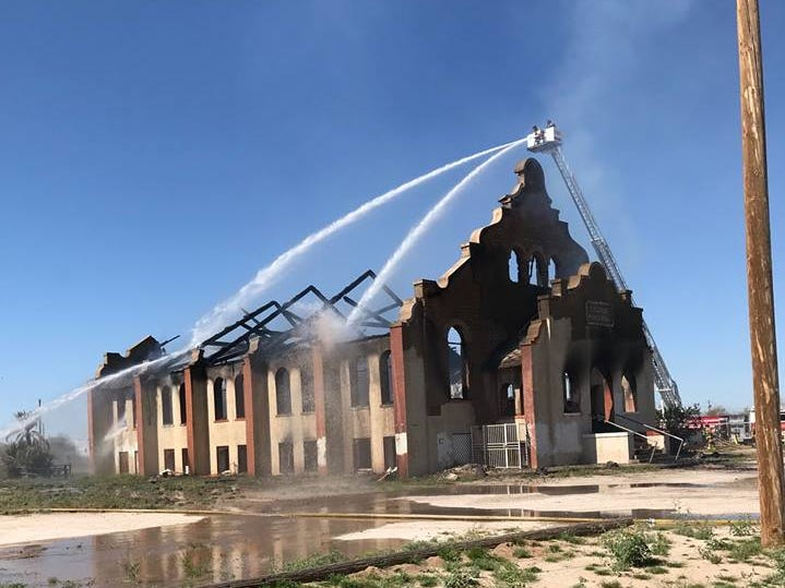 Fire crews with the Gila River Fire Department work to set the last of the fire out.