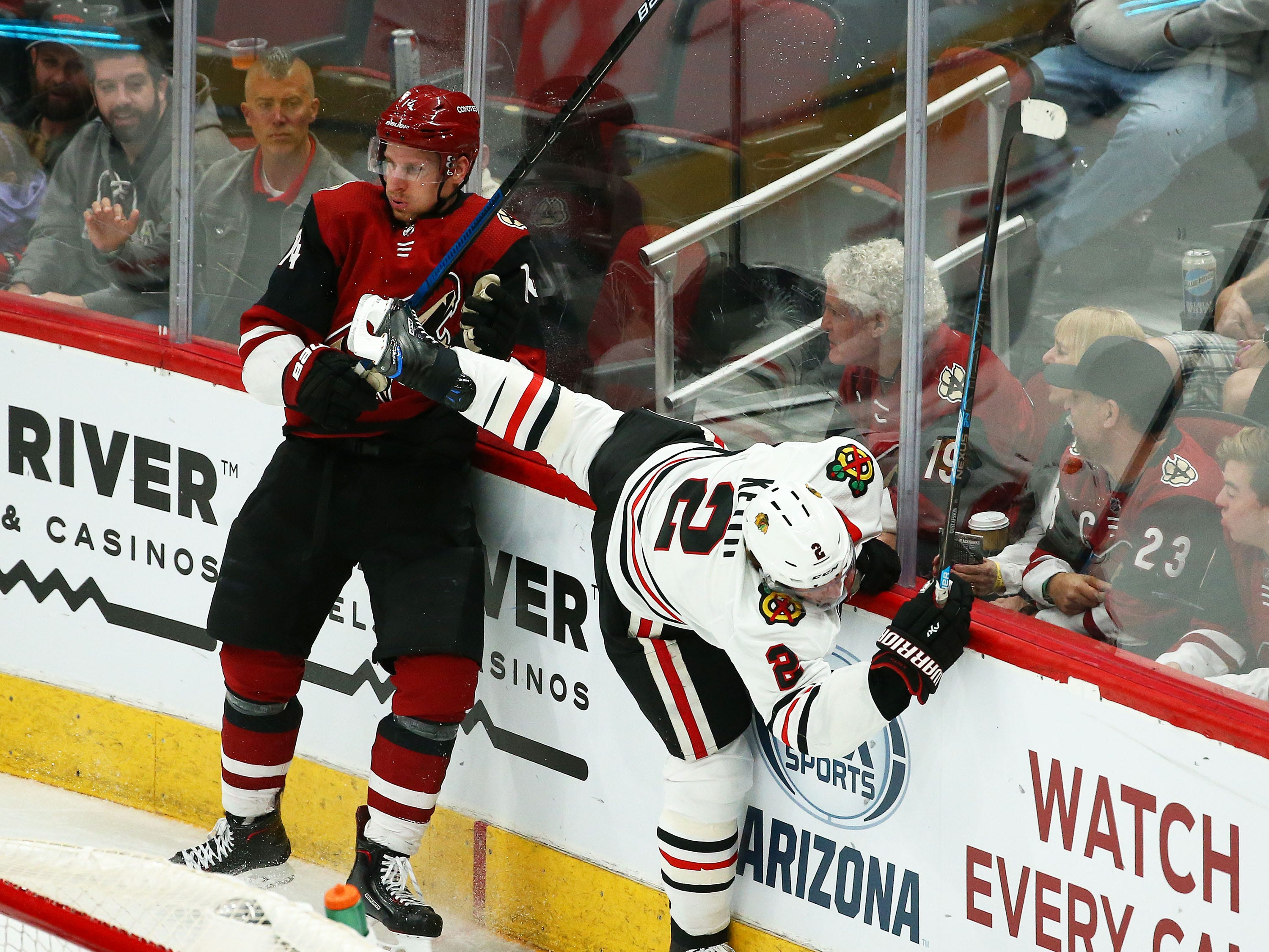Arizona Coyotes right wing Richard Panik (14) checks Chicago Blackhawks defenseman Duncan Keith (2) into the boards in the third period on Mar. 26, 2019, at Gila River Arena in Glendale, Ariz.