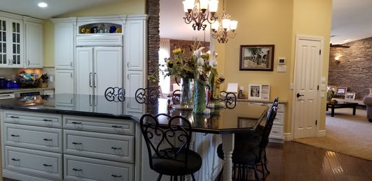 An island in the remodeled kitchen stretches nearly 15 feet long.