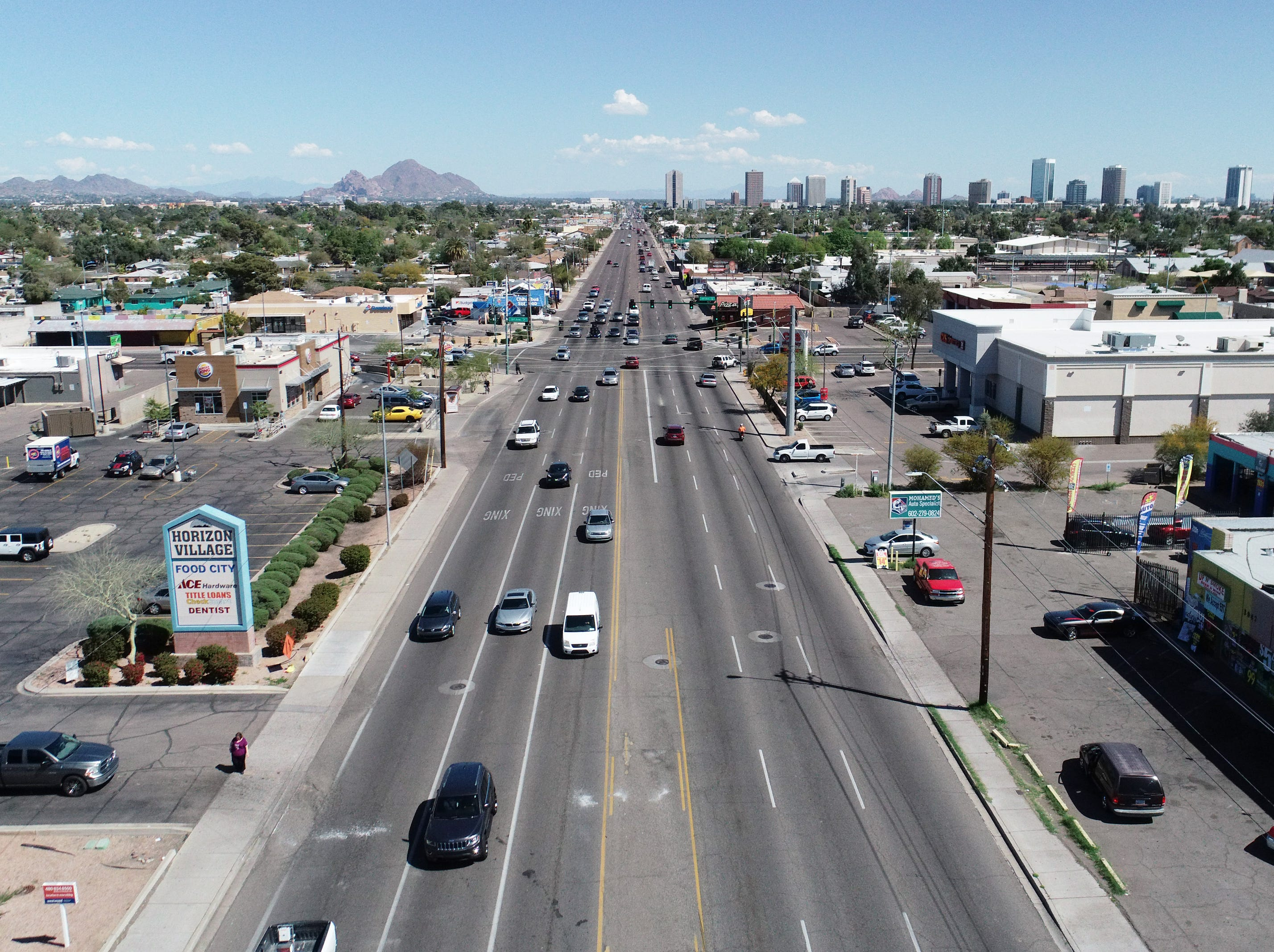 A drone view shows traffic on Indian School Road near 19th Avenue in Phoenix on March 18, 2019.
