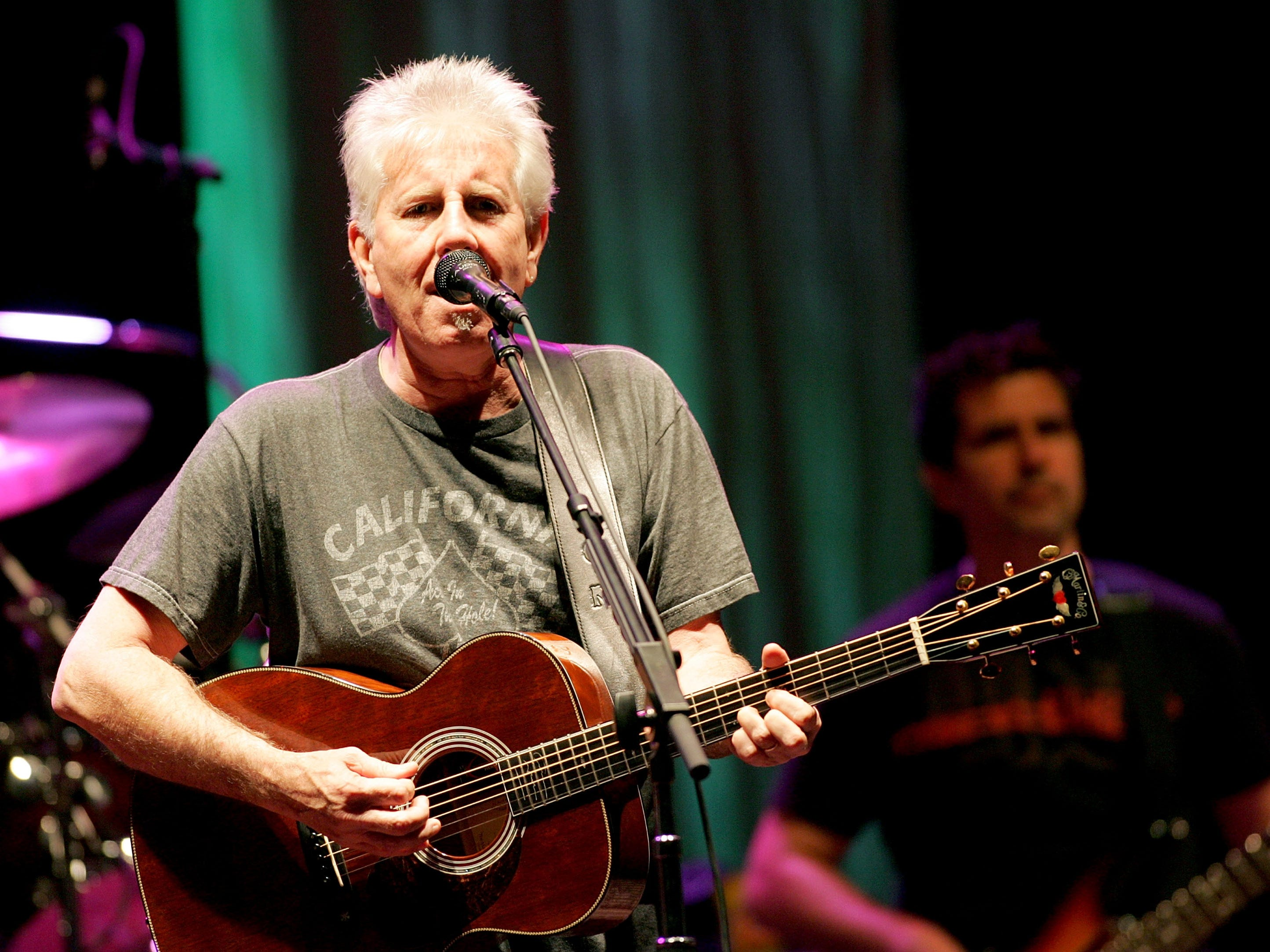 Graham Nash performs with Crosby Stills and Nash at the Beacon Theater August 1, 2005 in New York City.