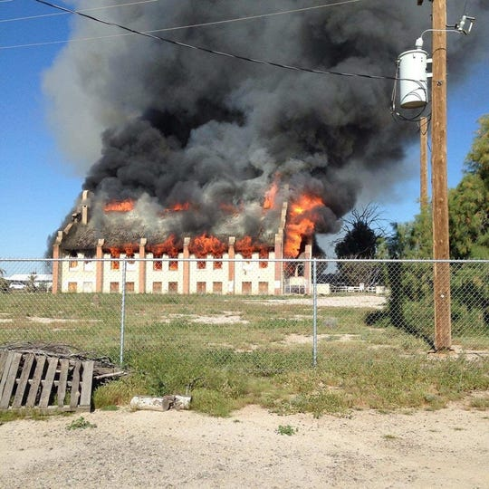 The entire church was engulfed in flames, spewing thick smoke into the air.