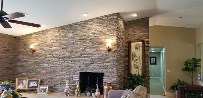 Raising the original eight-foot ceilings required adding rows of stone and ensuring they blended. Using a specialty saw, original mortar was removed, then fresh mortar applied once the additional stone courses reached ceiling height.
