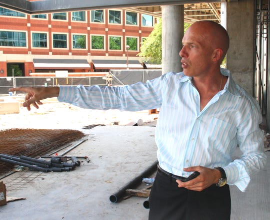 Ken Losch leads a tour of Centerpoint Condominiums in downtown Tempe in 2008.