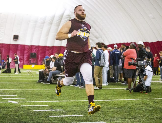 Former ASU lineman Casey Tucker runs the dash during the 2019 Football Pro Day held on campus, Wednesday, March 27, 2019.