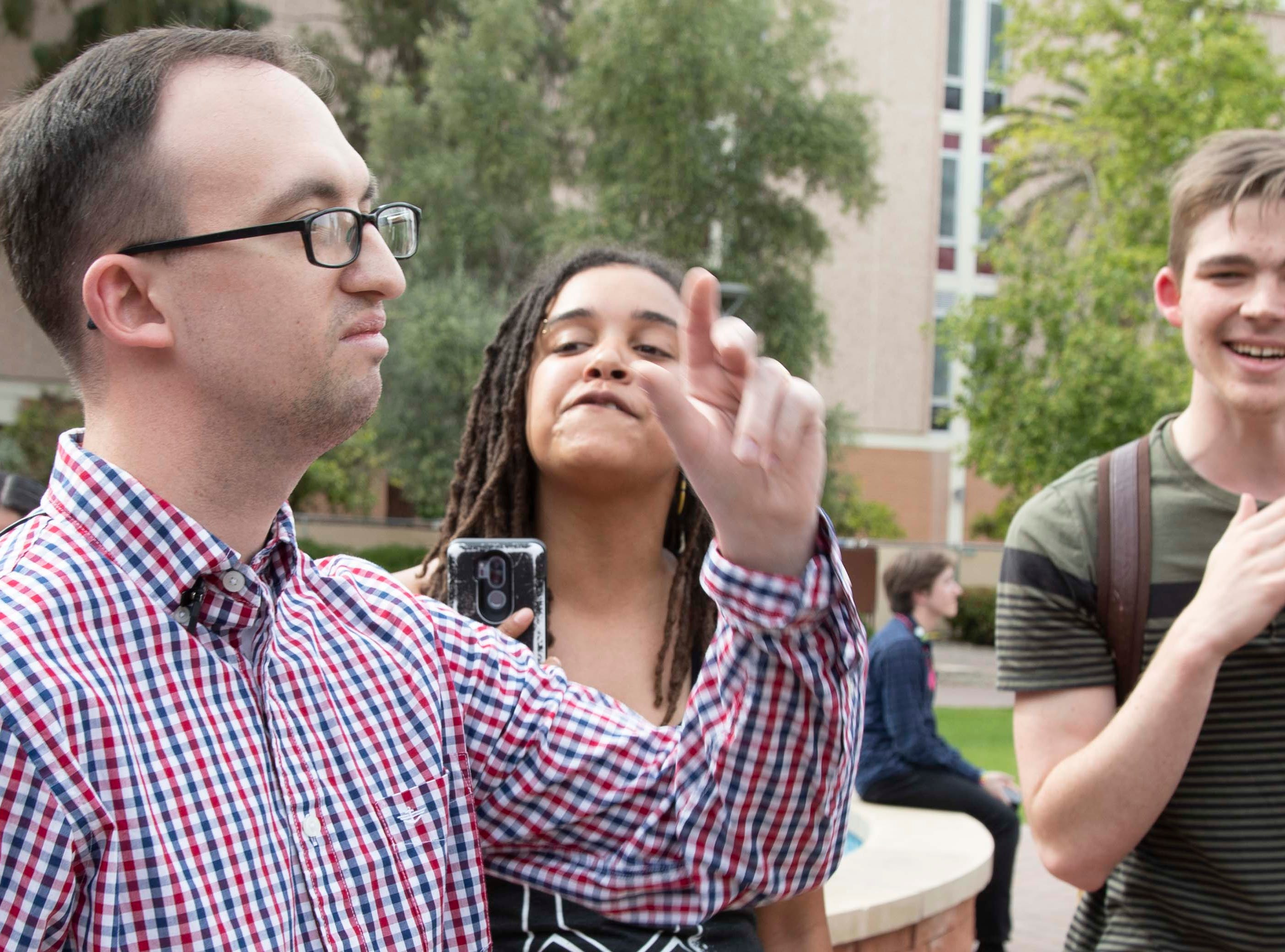College Republicans United President Mark Northway (left) publicly apologizes to student protesters in front of Old Main at ASU on March 26, 2019.