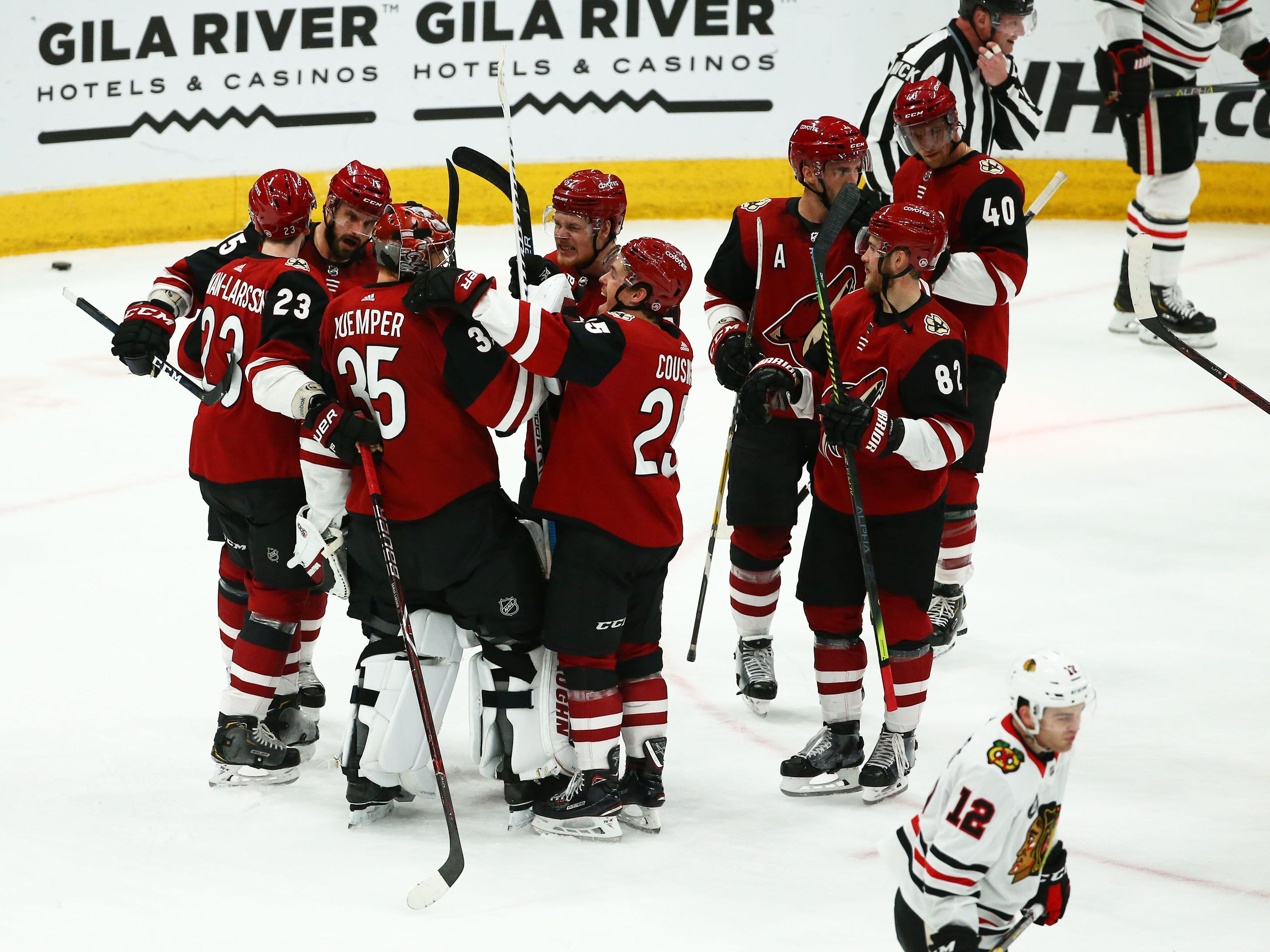 Arizona Coyotes celebrate their 1-0 win over the Chicago Blackhawks on Mar. 26, 2019, at Gila River Arena in Glendale, Ariz.