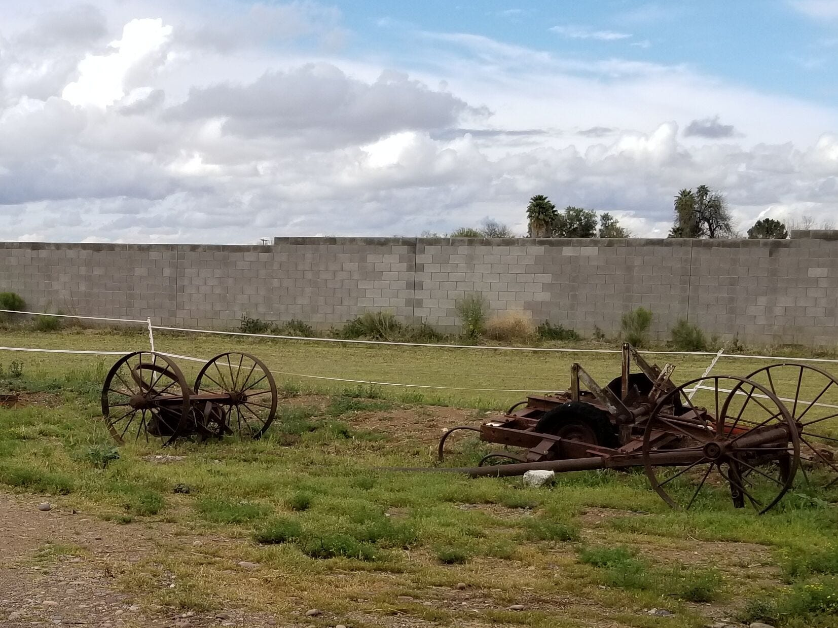 Old farm equipment dots the landscape, a reminder of the Cheatham family's long farming history in Laveen.
