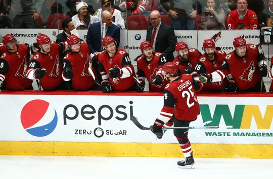 Arizona Coyotes center Nick Cousins (25) celebrates with his teammates after scoring a goal against the Chicago Blackhawks in the third period on Mar. 26, 2019, at Gila River Arena in Glendale, Ariz.