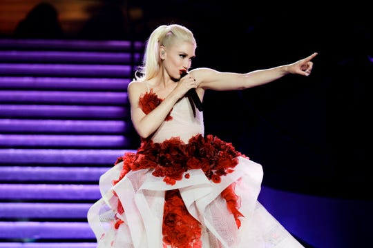 Gwen Stefani performing on stage.