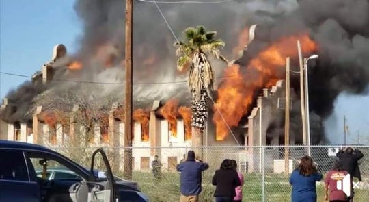 Onlookers watch as the historic church burns.