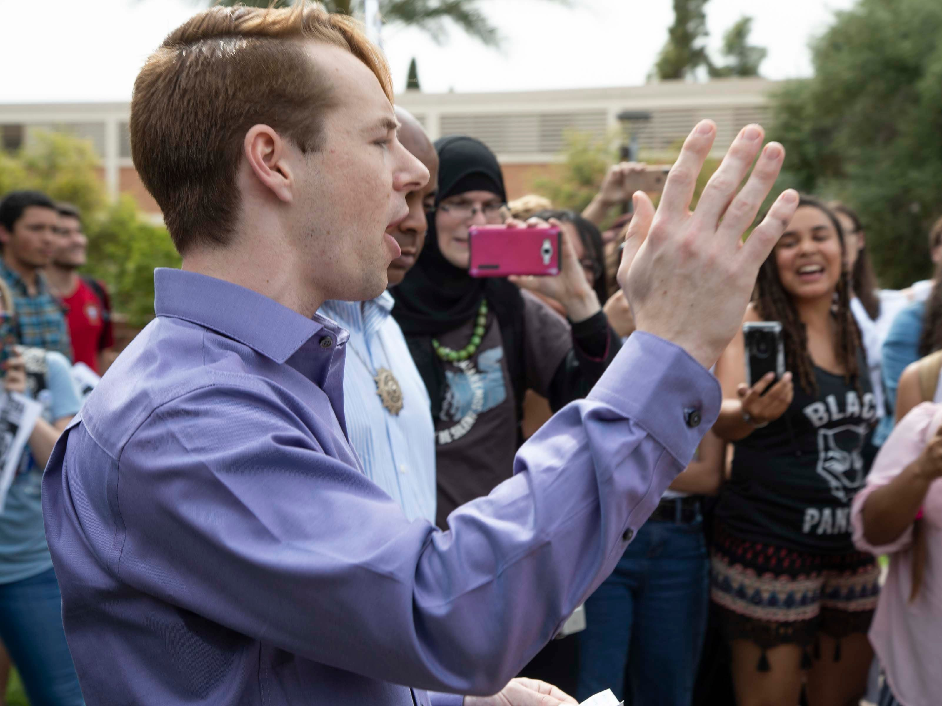 College Republicans United co-founder Kevin Decuyper publicly apologizes in front of Old Main at ASU on March 26, 2019.