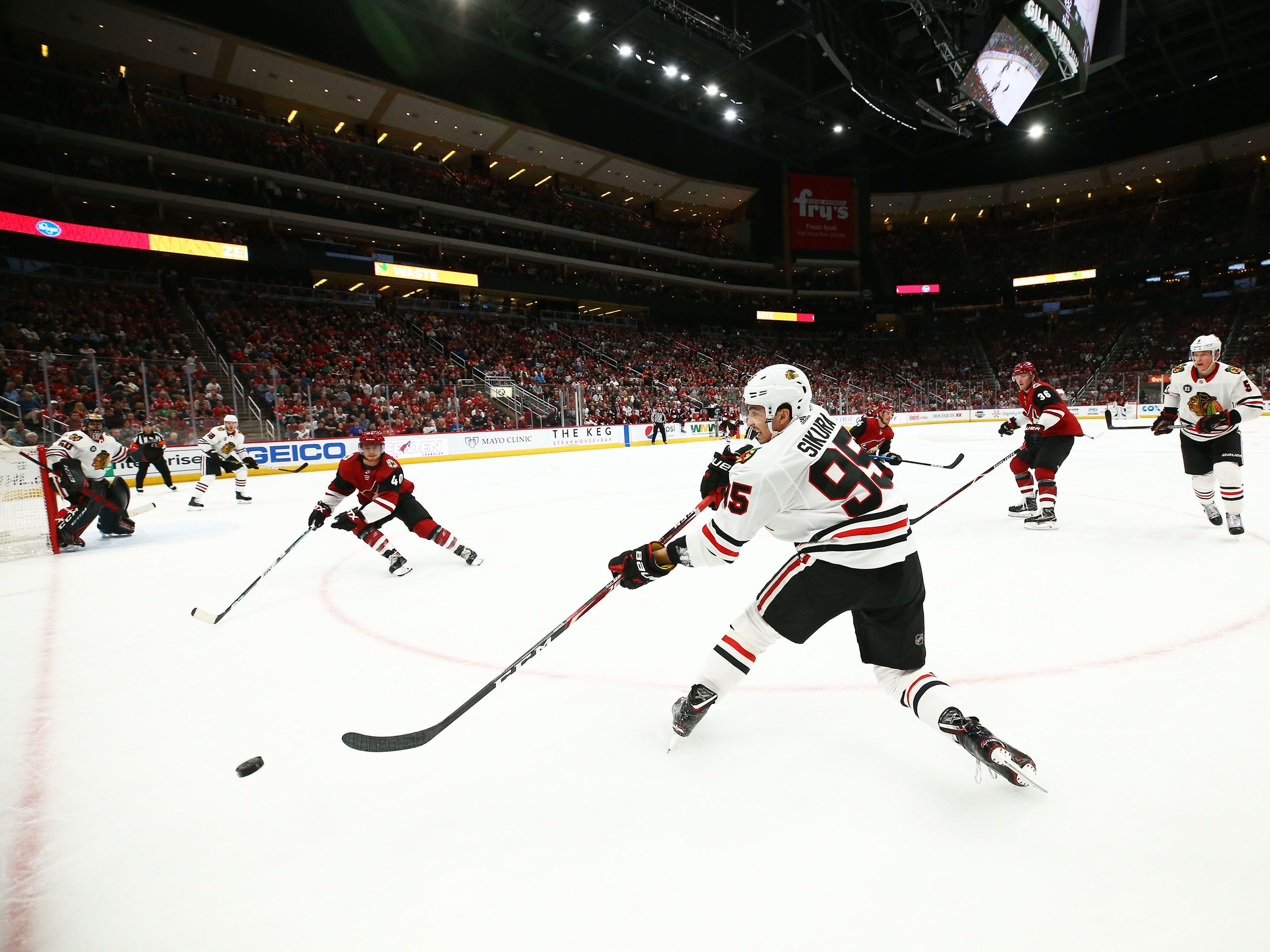 Chicago Blackhawks right wing Dylan Sikura (95) passes the puck against Arizona in the second period on Mar. 26, 2019, at Gila River Arena in Glendale, Ariz.