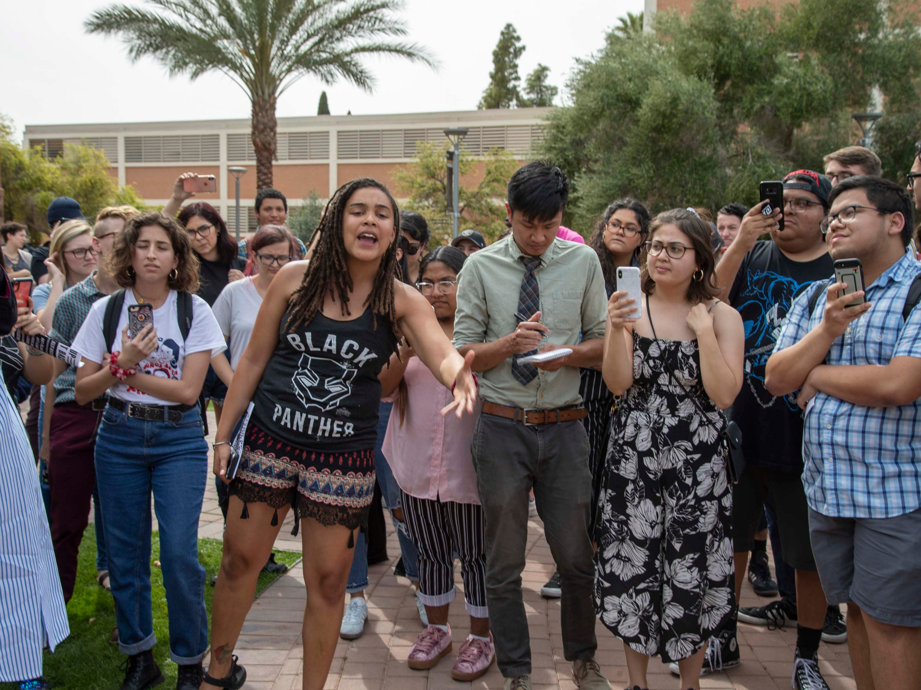 Student protesters yell at leaders of College Republicans United in front of Old Main at ASU on March 26, 2019. Dozens of ASU students came to protest against the College Republicans United group.