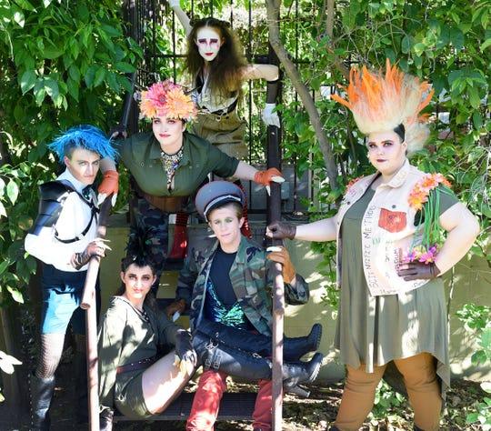 "The cast of Arizona State University's ""Triassic Parq"" in dinosaur costumes designed by Maci Hosler."