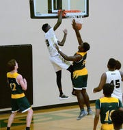 Tri-City Christian's Fallou Diagne dunks during a game.