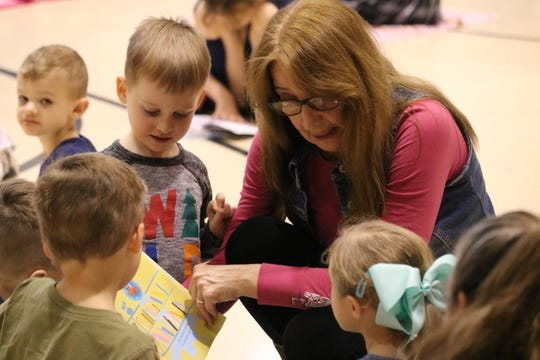 "Terri Winke, preschool coordinator at Ida Rupp Public Library, speaks with Immaculate Conception School students during their ""Literacy Day"" event on Wednesday."