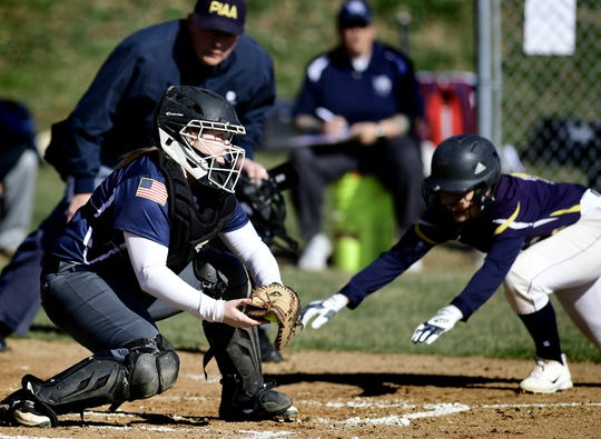 Dallastown catcher Allison Hoffman takes a late throw as Eastern York's Katie Lehman scores during softball action at Eastern Wednesday, March 27, 2019. Bill Kalina photo