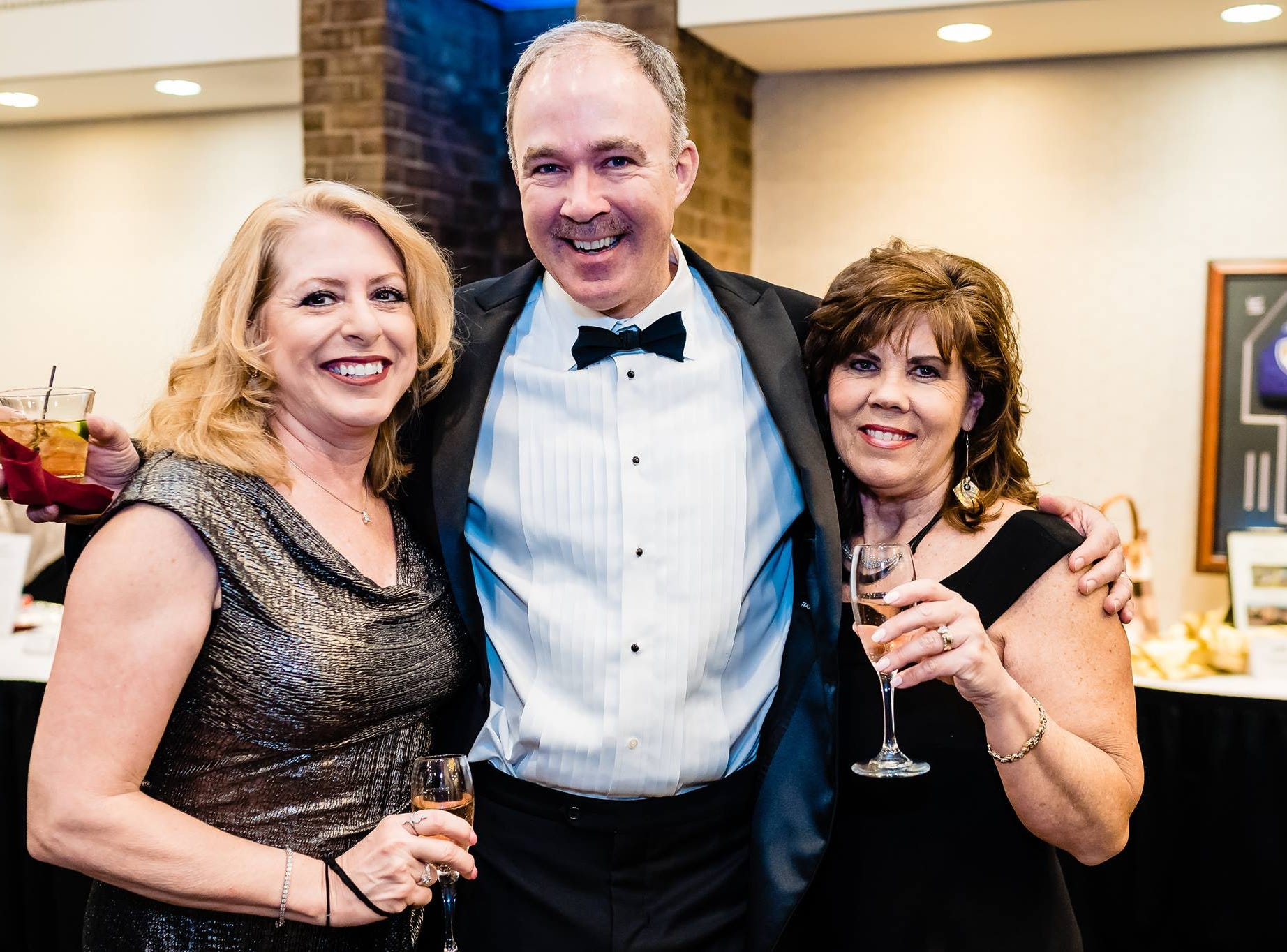 (Left to right) Pam Kinsley and John and Donna Forrey pose at Penn-Mar Human Services' annual Black Tie Gala, Saturday, March 2, 2019.