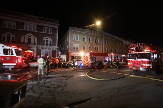 A four-alarm fire heavily damaged a building on Monroe Ave displacing residents.