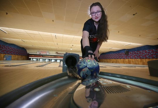 Elena Carr, a sophomore at Hilton High School, is the All Greater Rochester girls bowler of the year for 2019.  Elena is pictured at her home bowling alley, Pleasure Lanes on South Avenue in Hilton Tuesday, March 19, 2019.