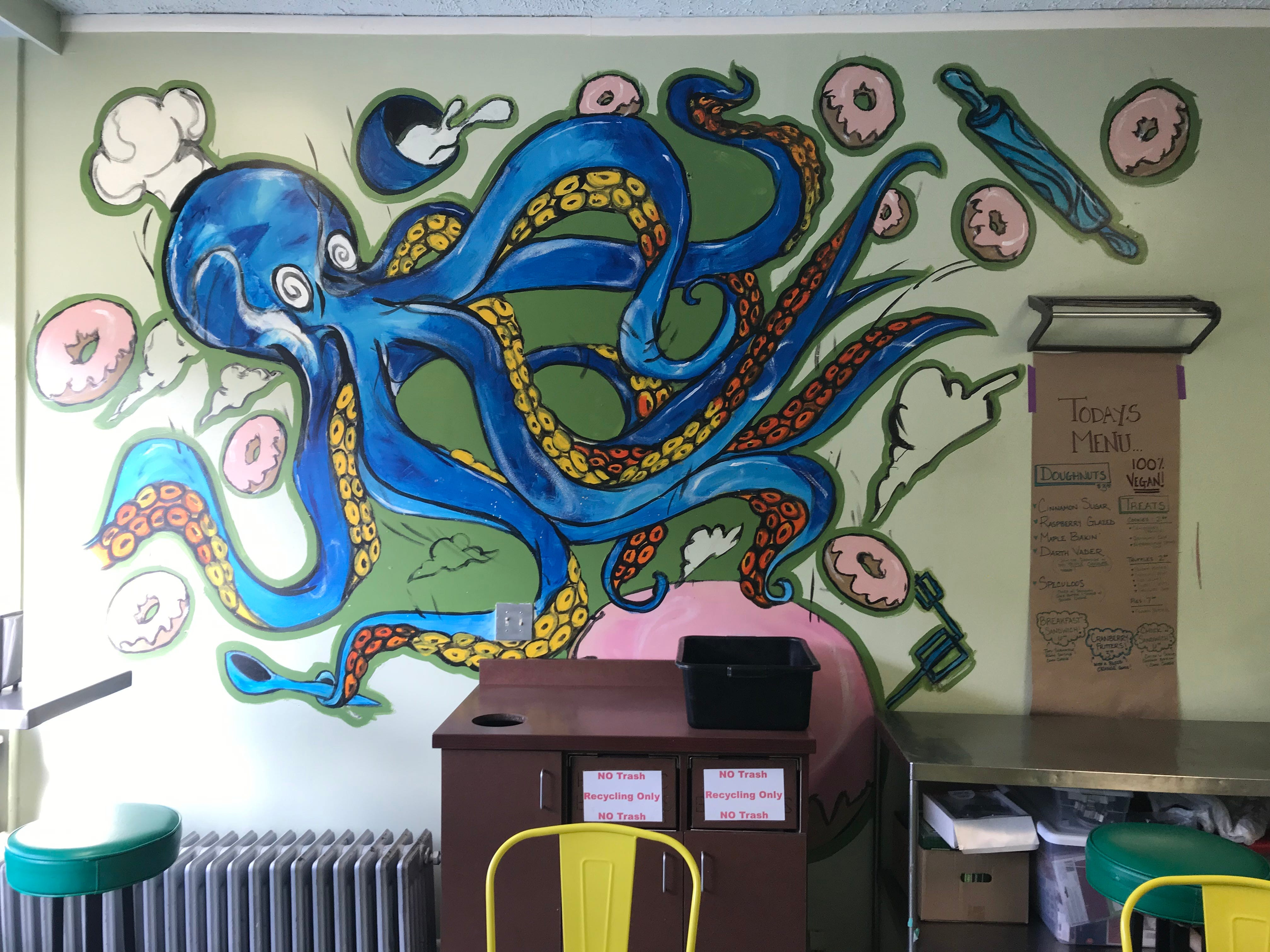 A colorful mural on the wall at Misfit Doughnuts.
