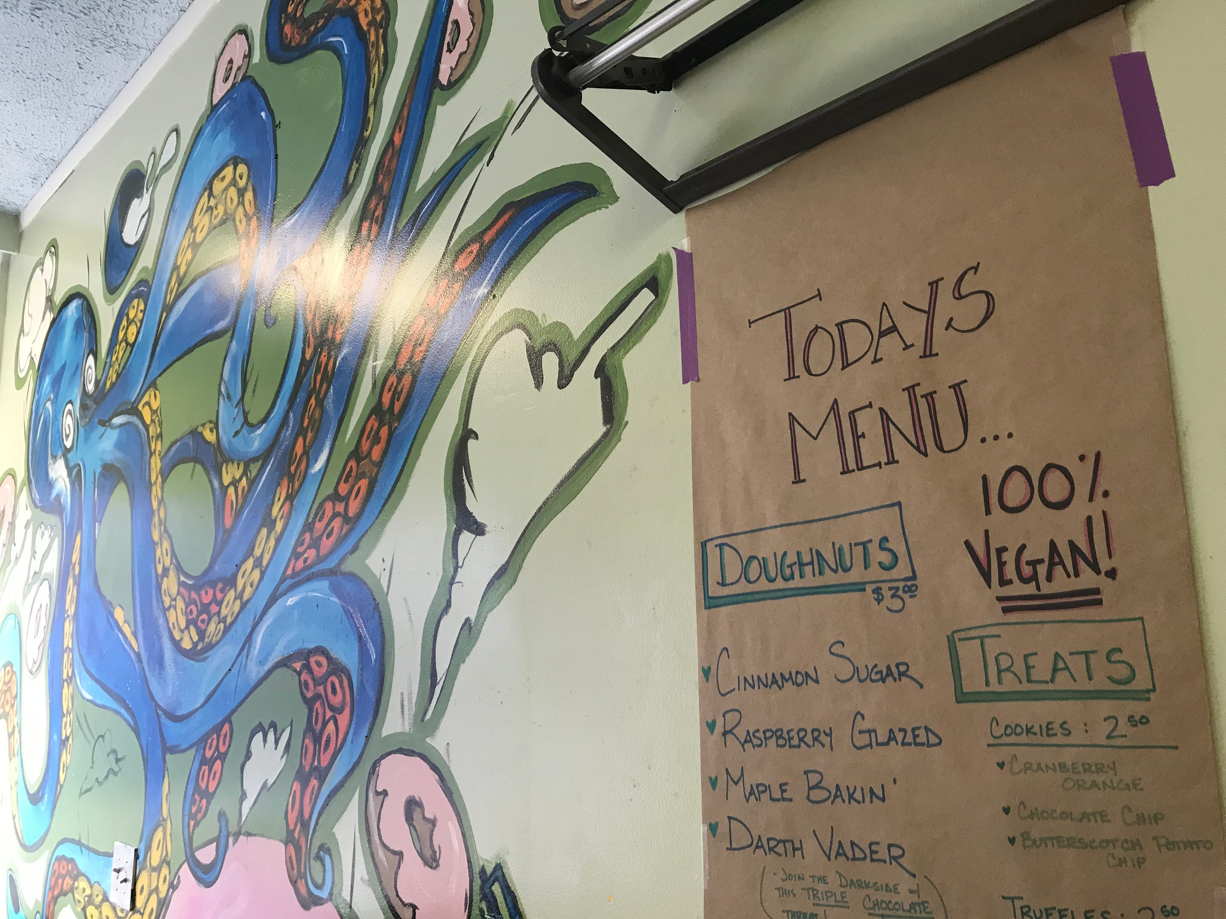 A hand written menu hangs at Misfit Doughnuts, which is entirely vegan.