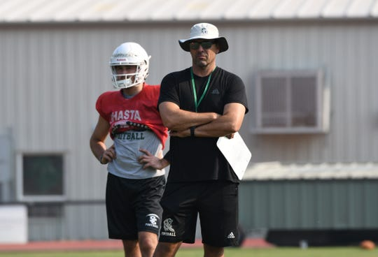 Shasta College coach Bryon Hamilton (right) looks on during a Knights practice in August 2018.