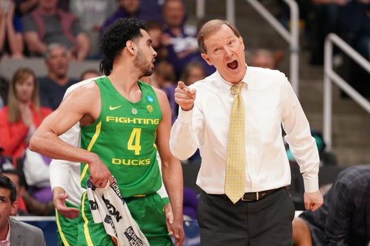 Mar 22, 2019; San Jose, CA, USA; Oregon Ducks head coach Dana Altman speaks to guard Ehab Amin (4) during the second half in the first round of the 2019 NCAA Tournament against the Wisconsin Badgers at SAP Center. Mandatory Credit: Kyle Terada-USA TODAY Sports