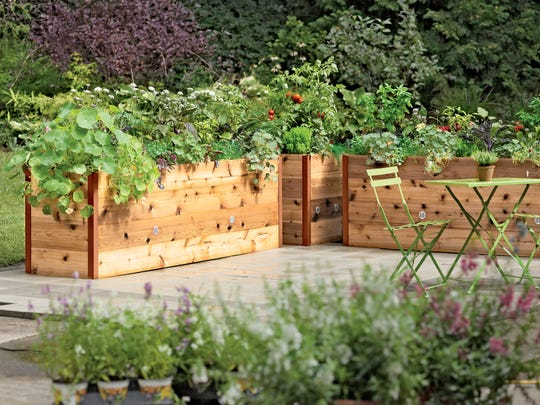This Vermont-made Elevated Cedar Raised Bed makes it easy for anyone to garden from their chair and on their deck.