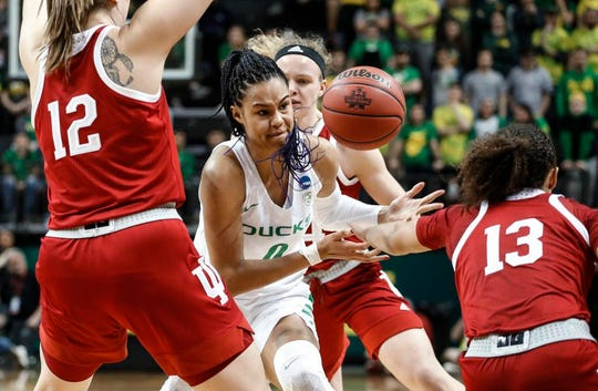 Oregon forward Satou Sabally (0) fights for the ball against Indiana guard Jaelynn Penn (13) during a second-round game of the NCAA women's college basketball tournament Sunday, March 24, 2019, in Eugene, Ore. (AP Photo/Thomas Boyd)