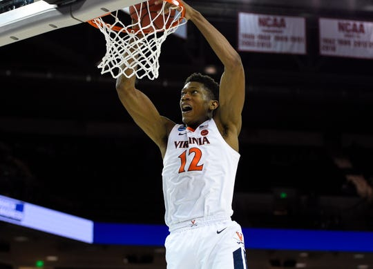 Mar 24, 2019; Columbia, SC, USA; Virginia Cavaliers guard De'Andre Hunter (12) dunks the ball during the second half against the Oklahoma Sooners in the second round of the 2019 NCAA Tournament at Colonial Life Arena. Mandatory Credit: Bob Donnan-USA TODAY Sports