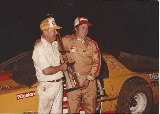Doug McCoun (right) and his father Dick celebrate winning the 1985 NASCAR Winston Racing Series championship.