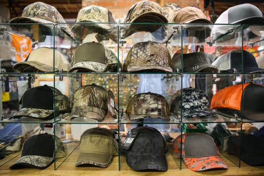 A display of hats at Cole's Army Surplus, 118 N. Chadbourne St.