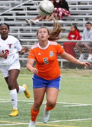 San Angelo Central's Averi Handy chases down the ball in a District 3-6A soccer match against Euless Trinity at Old Bobcat Stadium, Friday, March 22, 2019.