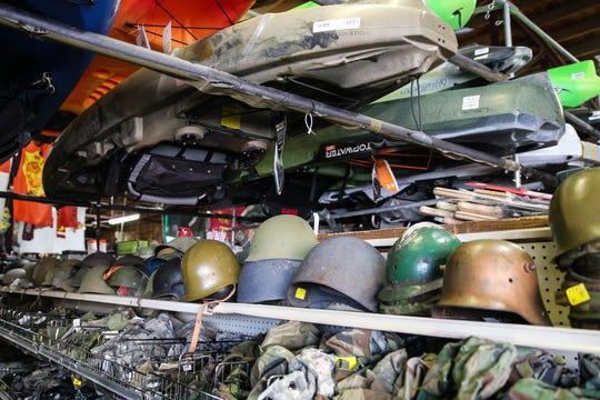 Kayaks are stacked above military surplus at Cole's Army Surplus.