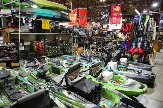 Kayaks and boating gear on display at Cole's Army Surplus.