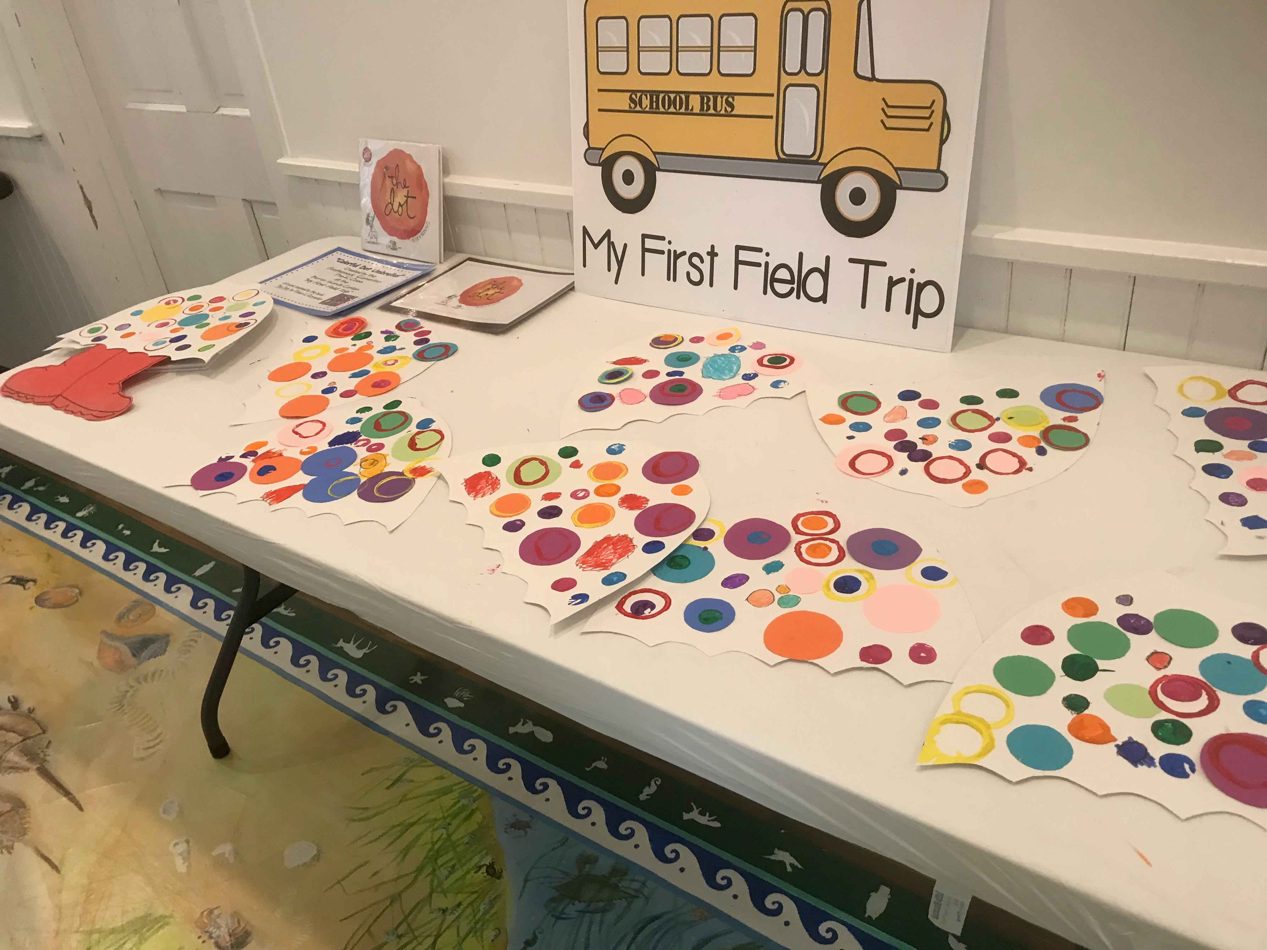 A table at the Barrier Islands Center holds colorful paper umbrellas created by Occohannock Elementary School pre-kindergarten students during a My First Field Trip event on Tuesday, March 26, 3019 in Machipongo, Virginia.