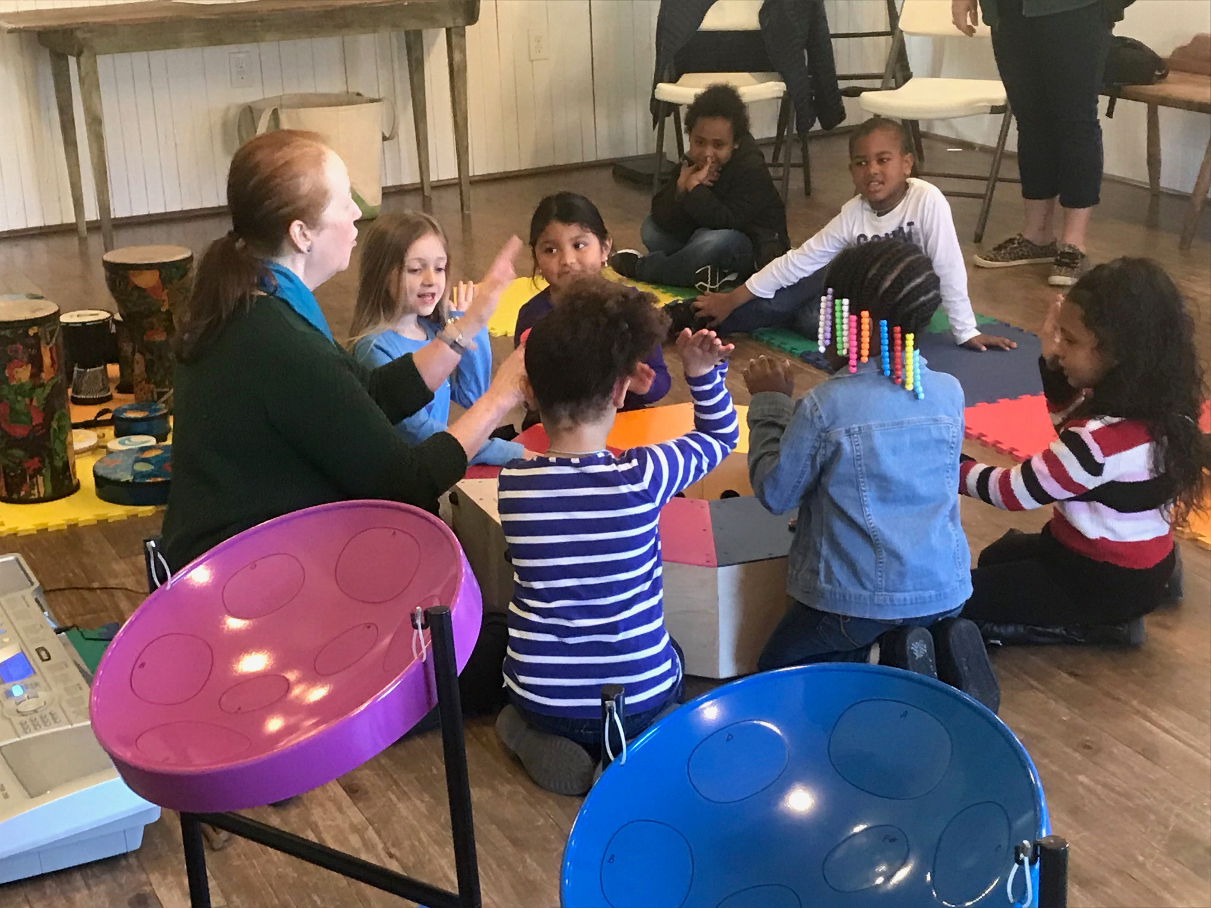 Pre-kindergarten students from Occohannock Elementary School play a large drum together during  a My First Field Trip event at the Barrier Islands Center in Machipongo, Virginia on Tuesday, March 26, 2019.