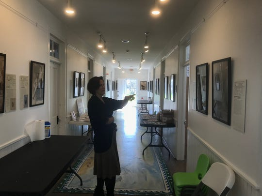 Monika Bridgforth, museum director, points out a portrait at the Barrier Islands Center in Machipongo, Virginia on Tuesday, March 26, 2019. The portraits are part of an exhibit about African-American soldiers from Virginia who fought overseas during World War I