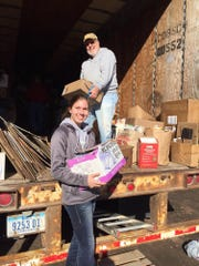 Lion Club member Tom Earley got an assist from Veronica Beck loading paper at the recycling trailer located at 3rd and Orleans last month.