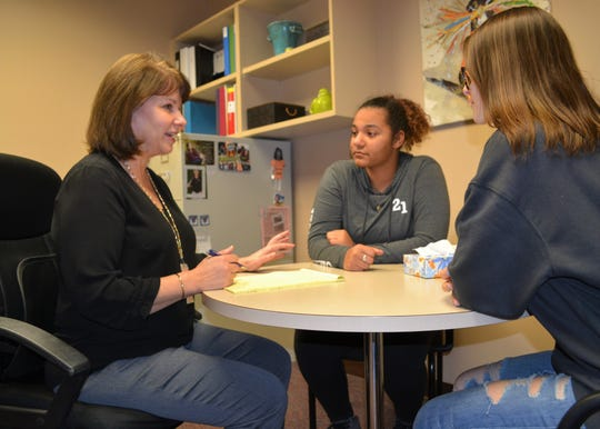 Washington High School counselor Patti Lake-Torbert talks with sophomores Angelique Kiyombo and Norilyn Binney on Tuesday, March 26, 2019,  about the stress of the upcoming standardized testing season.