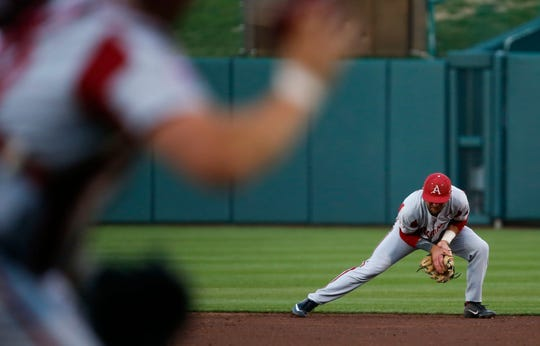 Arkansas Razorback Jack Kenley fields a ground ball and turns an out during a game against the Missouri State Bears at Hammons Field in Springfield, Mo. on Tuesday, March 26, 2019.
