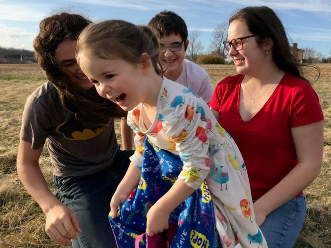 Carter, Wyatt and Julia Bussey play with their sister Rebecca in their backyard in Waynesboro on Friday, March 15, 2019. Rebecca Bussey is one of 30-40 kids in the U.S. with the rare and potentially fatal disease Systemic Juvenile Idiopathic Arthritis.