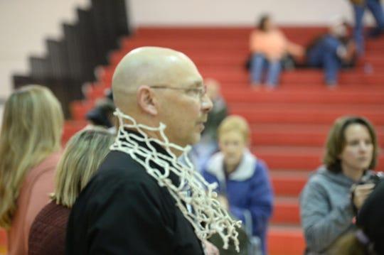 Riverheads girls basketball coach Gene Wassick celebrates at Region 1B championship this season.