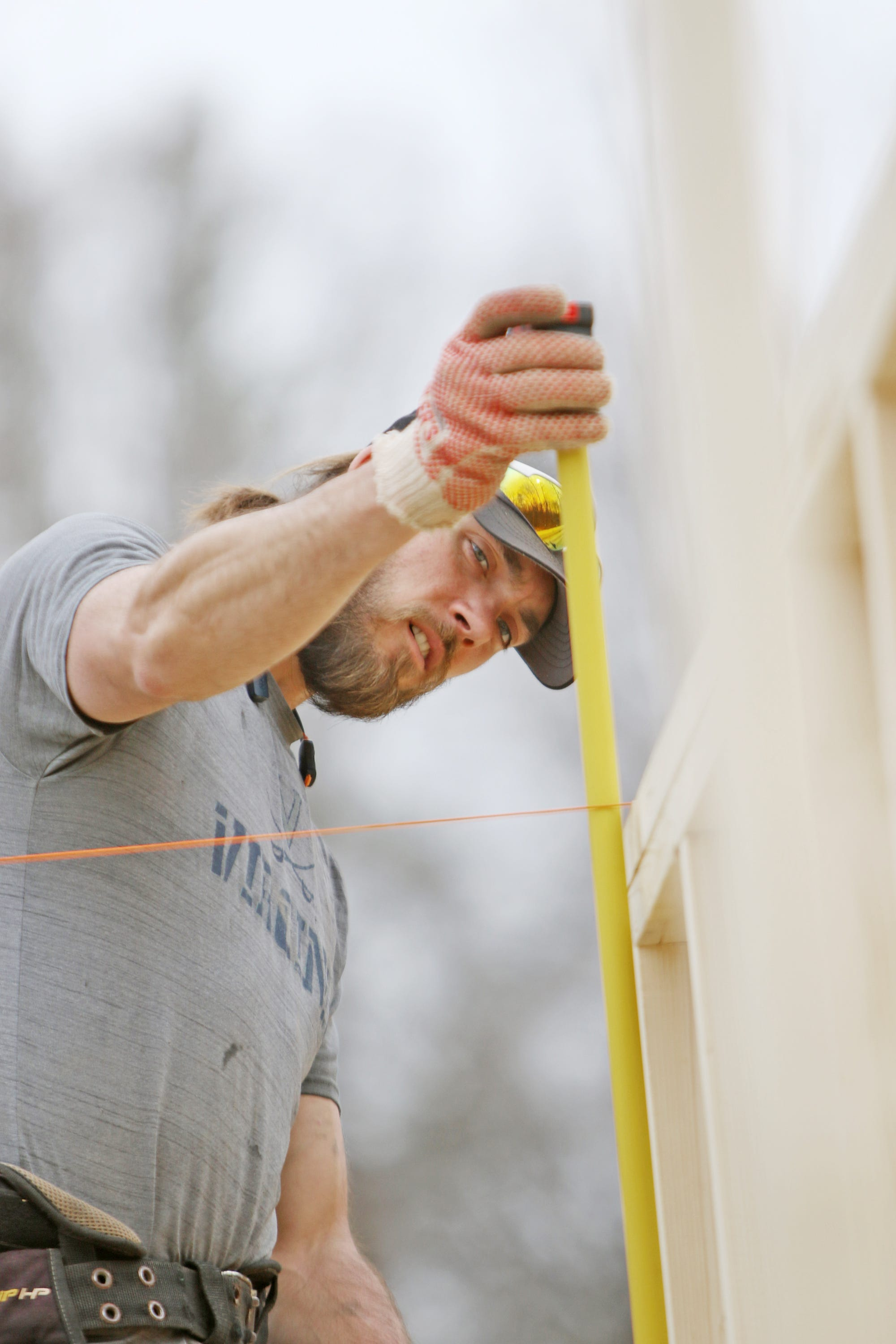 Getting a measure of freedom: Trevor Lane frames up a house in Crozet with Faith Builders Construction on Monday, March 25, 2019. Lane, who is serving out a drug conviction sentence at Middle River Regional Jail, got a job with the construction company as part of the work release program at Middle River which is designed to help with an inmate's transition back into the community.