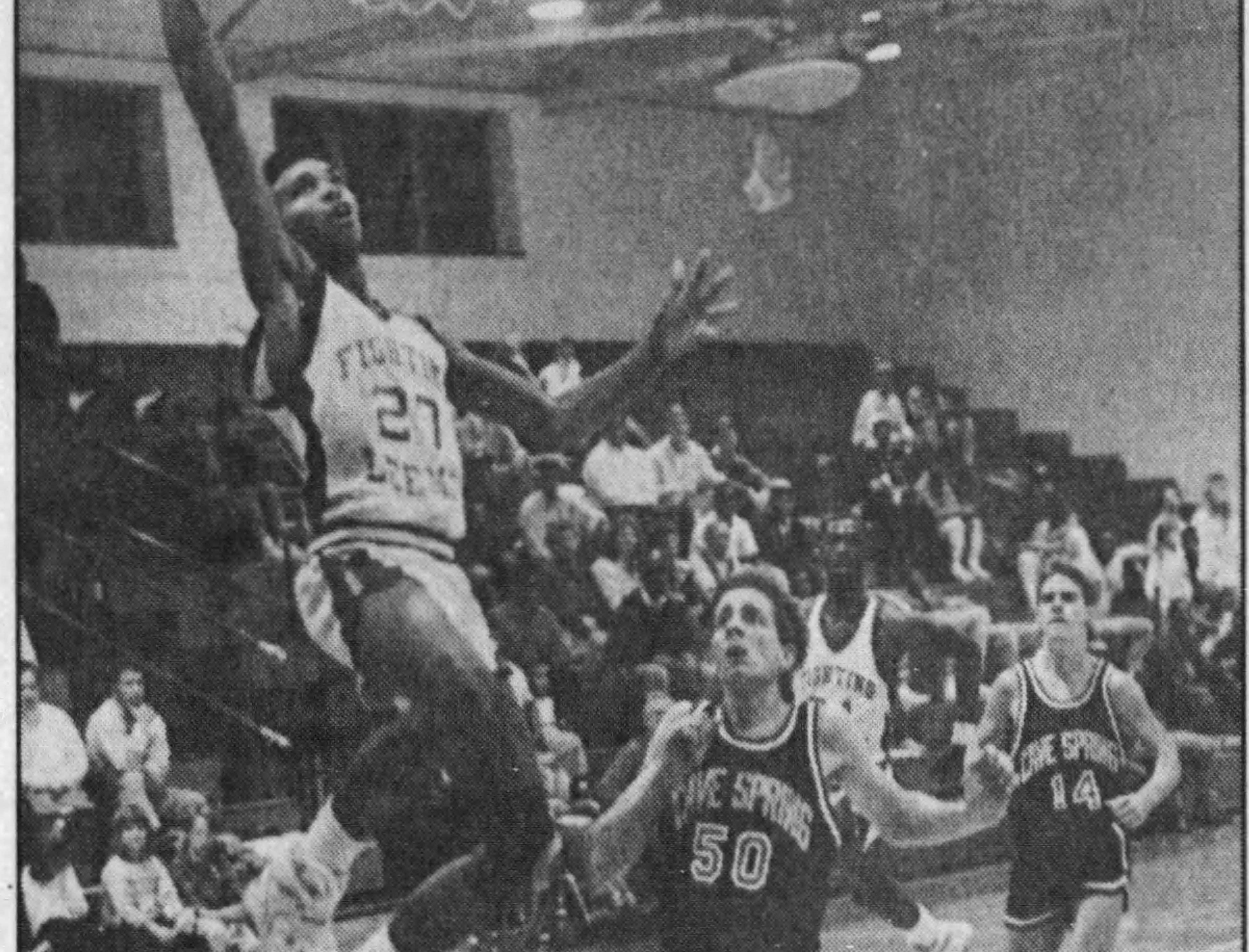 Keith Scott takes the ball to the basket during a 1989 Lee High game against Cave Spring.