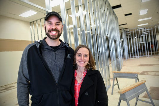 Jay and Tina Mrozek pose for a photograph at BlackLight Adventures, under construction Tuesday, March 26, at 240-33rd Ave. S, St. Cloud.