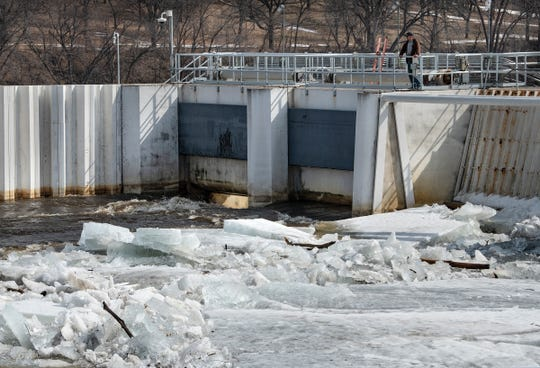 Large chunks of ice float downstream and gather at the St. Cloud Dam Wednesday, March 27, near St. Cloud State University.